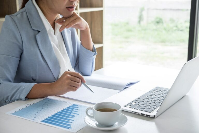 Business woman accountant financier working audit and calculating expense financial annual report